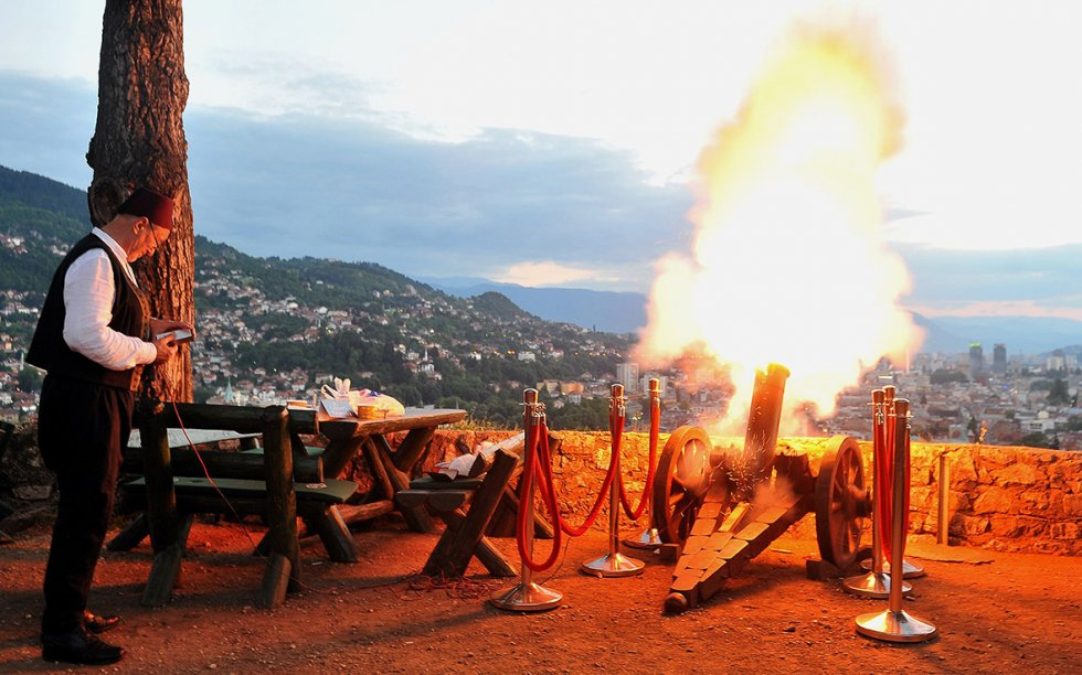 man shooting cannon during eid in bosnia and herzegovina